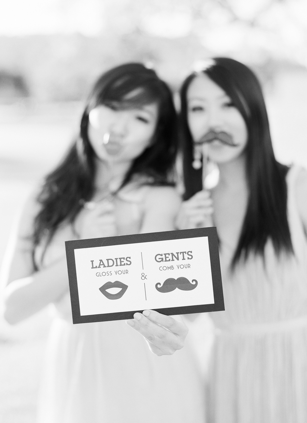 Event Guests Pose with Lips and Moustache Accessories