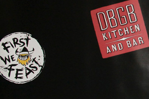 A Backdrop With DBGB and First We Feast Logos for the Restaurant's 5th Anniversary