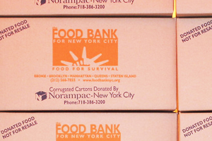 Stacked Boxes to Remind Participants of the Non-Profit's Mission - Ending Hunger
