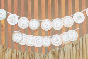 A Customized Floral Garland Decorates the Photo Background
