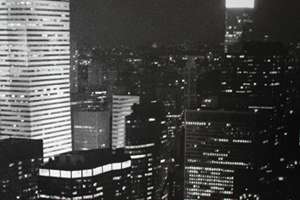 A Black and White Photo Shows the City Skyline at Night