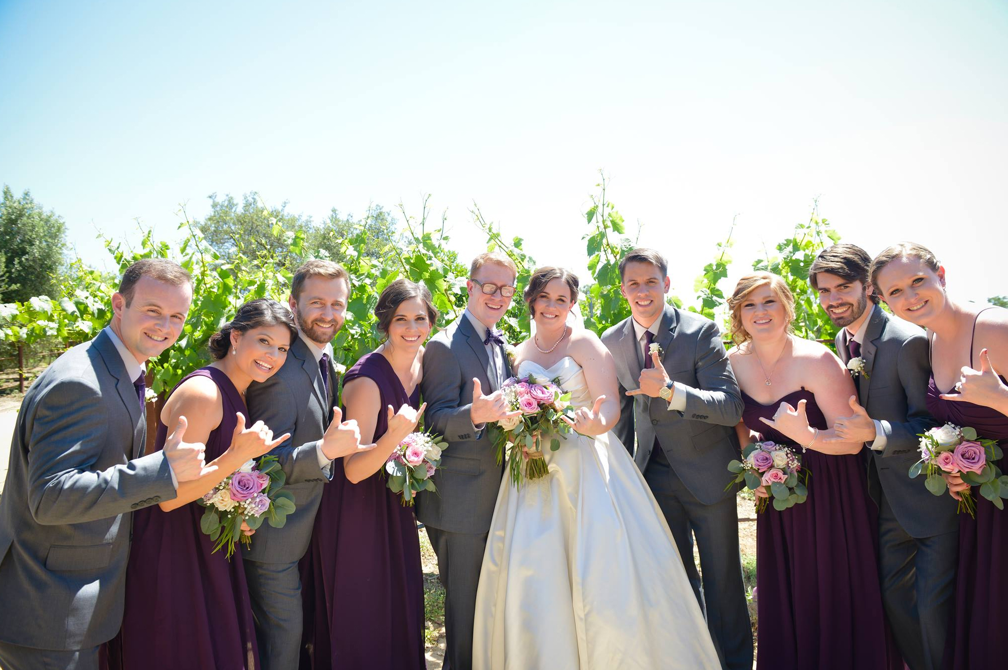 Purple and Gray Wedding Party Pose in the Vineyards