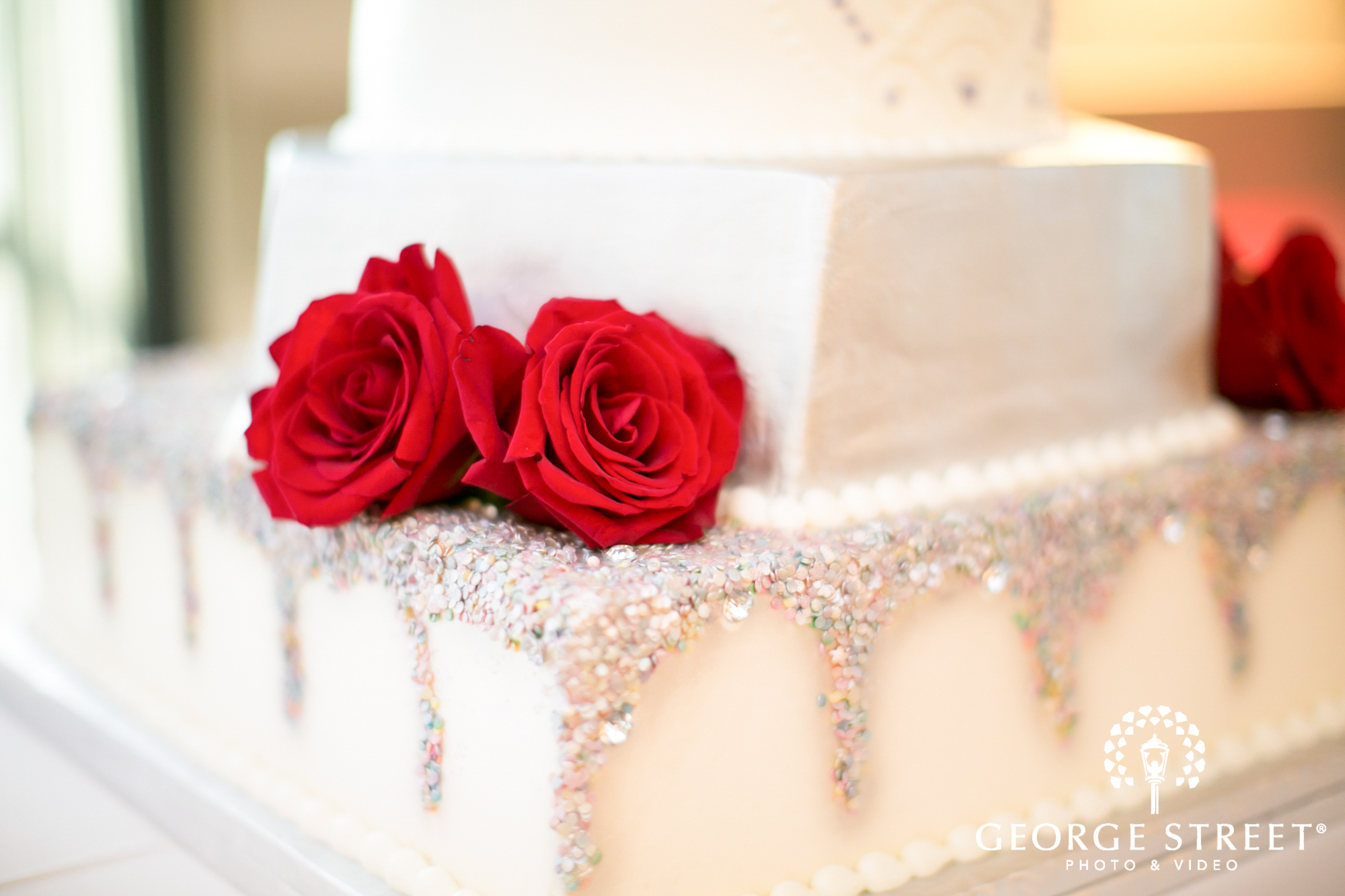 White Wedding Tiered Cake with Red Roses